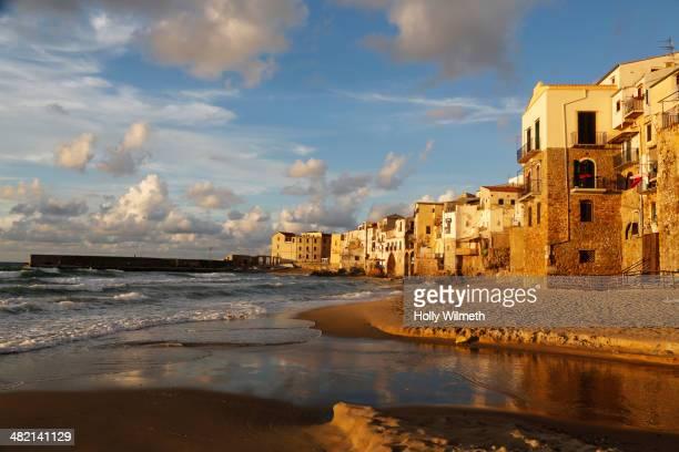 Waves washing up on Cefalu coastline, Cefalu, Sicily, Italy