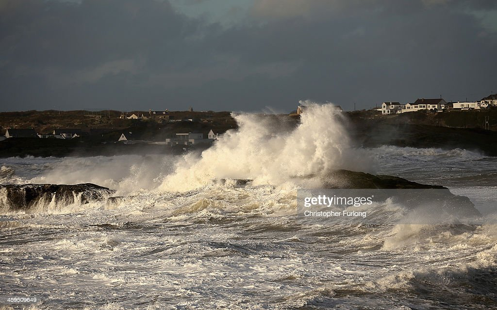 Waves whipped up by the wind crash against rocks at Trearddur Bay on December 27, 2013 in Anglesey, United Kingdom. A yellow 'be aware' warning has been issued for many parts of Britain as the country is affected by gale force winds and heavy rain.