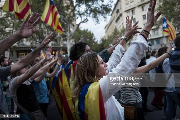 Waving Catalan flags and raising open hands massive crowd rally to demand the release of imprisoned Catalan leaders Jordi Sanchez and Jordi Cuixart...
