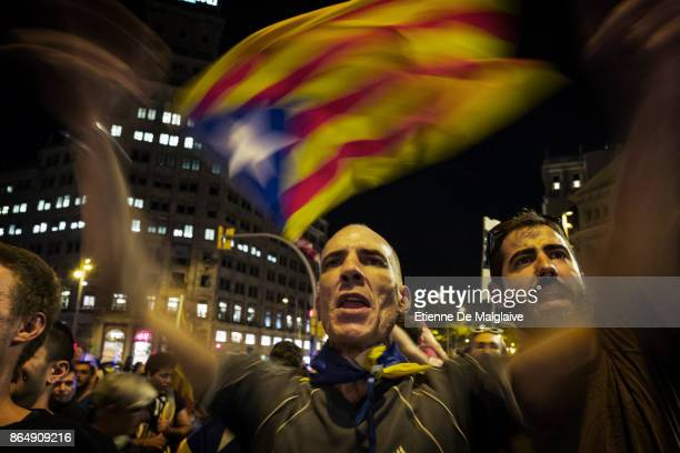 Waving Catalan flags and shouting here at national Spanish network TVE crew massive crowd rally to demand the release of imprisoned Catalan leaders...