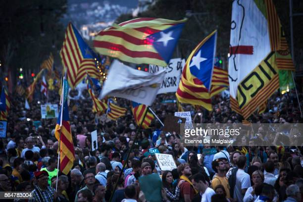 Waving Catalan flags and sign calling for Europe help massive crowd rally to demand the release of imprisoned Catalan leaders Jordi Sanchez and Jordi...