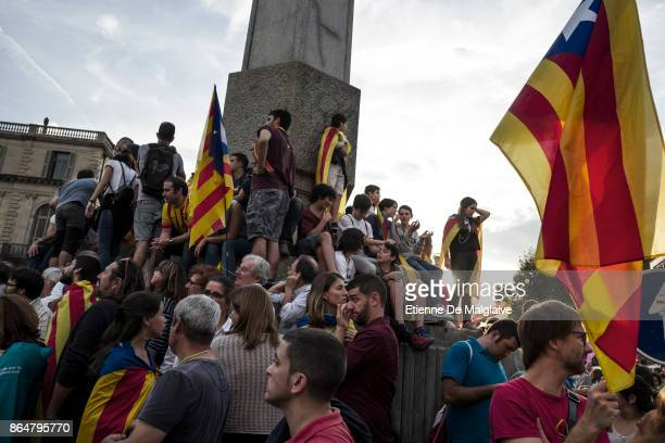Waving Catalan flags massive crowd rally to demand the release of imprisoned Catalan leaders Jordi Sanchez and Jordi Cuixart at a demonstration for...
