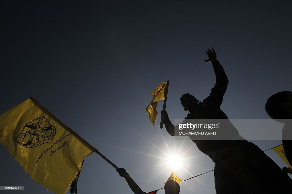 Waving Fatah's yellow banners, hundreds of thousands of supporters of Palestinian president Mahmud Abbas's party held on January 4, 2013 their first mass rally in Gaza since Hamas seized control of the territory in 2007. Hamas, in a sign of reconciliation with Fatah, permitted the rally to go ahead as the climax of a week of Gaza festivities celebrating the 48th anniversary of Fatah taking up arms against Israel. AFP PHOTO / MOHAMMED ABED