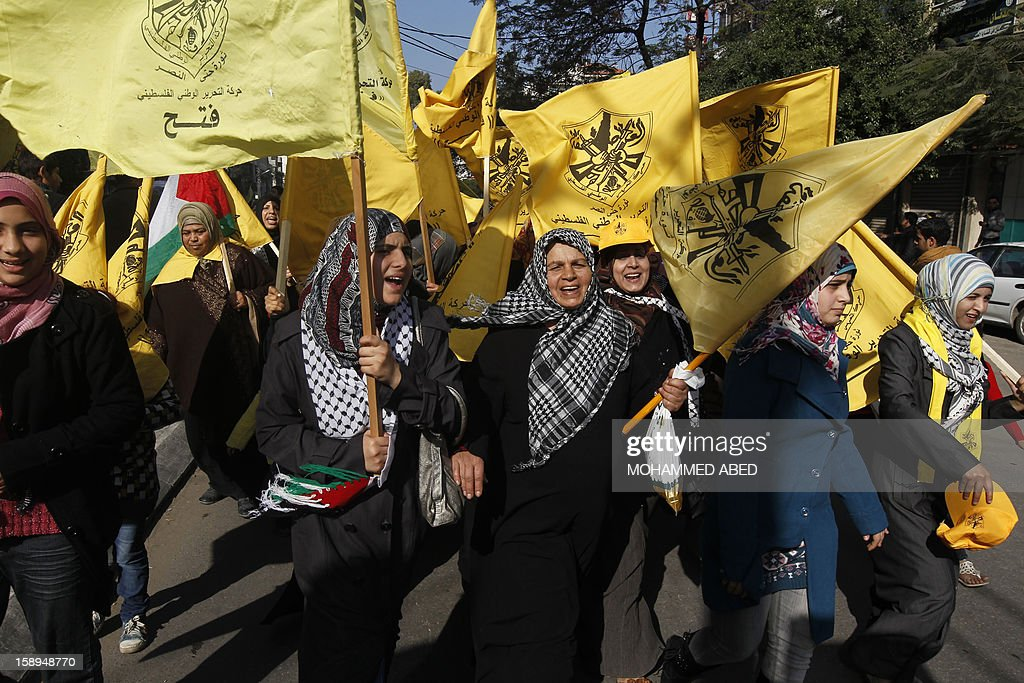 Waving Fatah's yellow banners, veiled supporters of Palestinian president Mahmud Abbas's party take part on January 4, 2013 in Fatah's first mass rally in Gaza since Hamas seized control of the territory in 2007. Hamas, in a sign of reconciliation with Fatah, permitted the rally to go ahead as the climax of a week of Gaza festivities celebrating the 48th anniversary of Fatah taking up arms against Israel. AFP PHOTO / MOHAMMED ABED