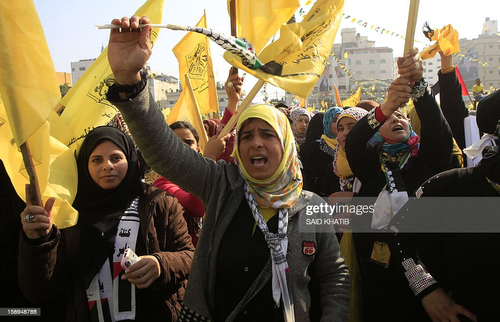 Waving Fatah's yellow banners, veiled women supporting Palestinian president Mahmud Abbas's party take part on January 4, 2013 in Fatah's first mass rally in Gaza since Hamas seized control of the territory in 2007. Hamas, in a sign of reconciliation with Fatah, permitted the rally to go ahead as the climax of a week of Gaza festivities celebrating the 48th anniversary of Fatah taking up arms against Israel. AFP PHOTO / SAID KHATIB