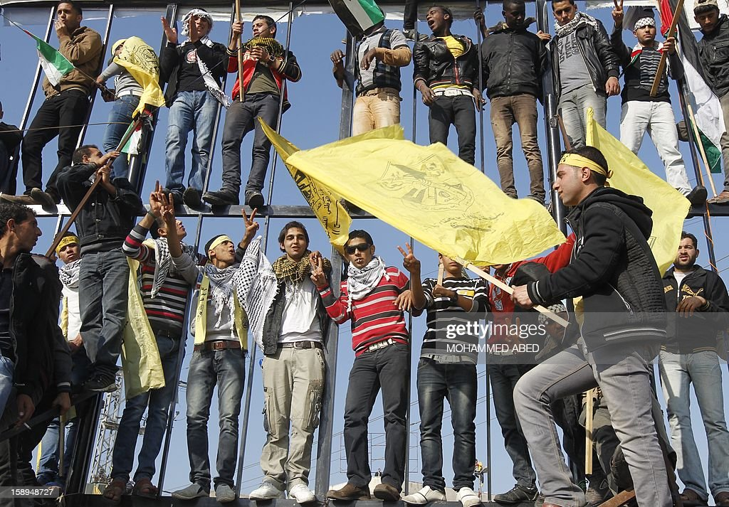 Waving Fatah's yellow banners, young supporters of Palestinian president Mahmud Abbas's party hold on January 4, 2013 their first mass rally in Gaza since Hamas seized control of the territory in 2007. Hamas, in a sign of reconciliation with Fatah, permitted the rally to go ahead as the climax of a week of Gaza festivities celebrating the 48th anniversary of Fatah taking up arms against Israel. AFP PHOTO / MOHAMMED ABED