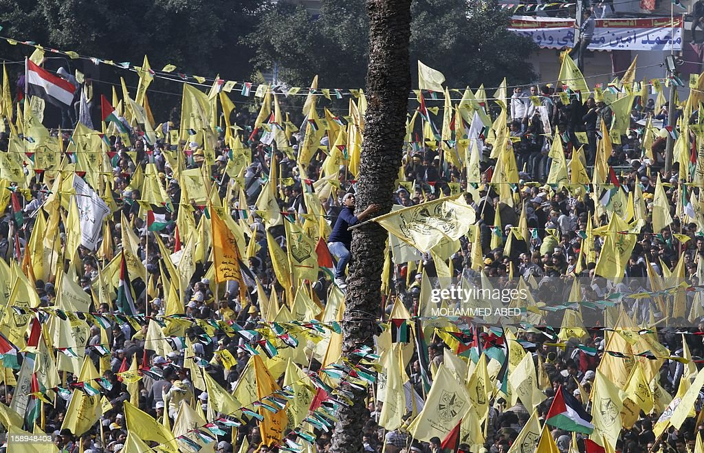 Waving Fatah's yellow flags, hundreds of thousands of supporters of Palestinian president Mahmud Abbas's party hold on January 4, 2013 their first mass rally in Gaza since Hamas seized control of the territory in 2007. Hamas, in a sign of reconciliation with Fatah, permitted the rally to go ahead as the climax of a week of Gaza festivities celebrating the 48th anniversary of Fatah taking up arms against Israel. AFP PHOTO / MOHAMMED ABED