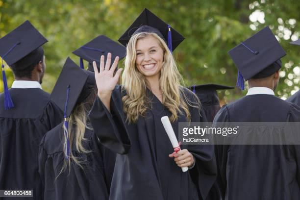 Waving Graduation Student