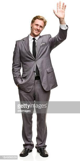 Homme en costume agitant