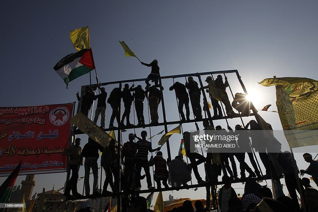 Waving national flags and Fatah's yellow banners, hundreds of thousands of supporters of Palestinian president Mahmud Abbas's party held on January 4, 2013 their first mass rally in Gaza since Hamas seized control of the territory in 2007. Hamas, in a sign of reconciliation with Fatah, permitted the rally to go ahead as the climax of a week of Gaza festivities celebrating the 48th anniversary of Fatah taking up arms against Israel. AFP PHOTO / MOHAMMED ABED