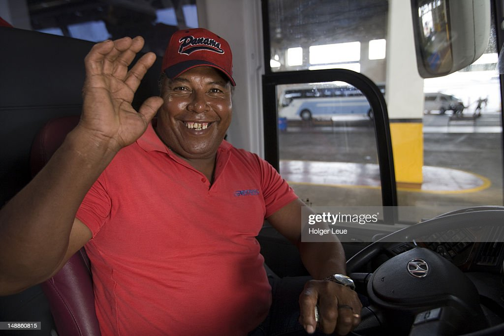 Waving Panamanian bus driver.