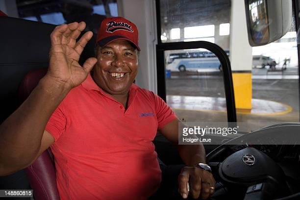 Waving Panamanian bus driver.
