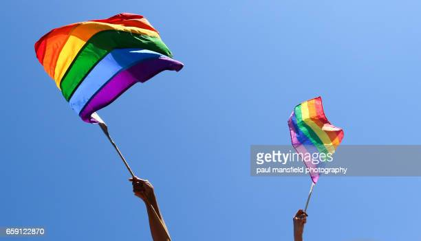 Waving rainbow flags