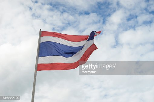 waving Thai flag of Thailand with blue sky background. : Stock Photo