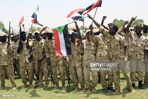 Waving the national flag Sudanese soldiers rally in the capital Khartoum following a speech by Field Commander Brig Mohammed Hamdan Hemaidti on May...