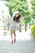 Waving woman while walking