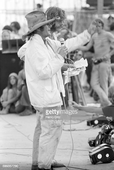 Wavy Gravy speaks onstage at the free Woodstock Music and Art Fair The festival took place on Max Yasgur's dairy farm which he rented to event...