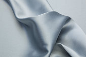Wavy satin fabric texture closeupWavy satin fabric texture closeup
