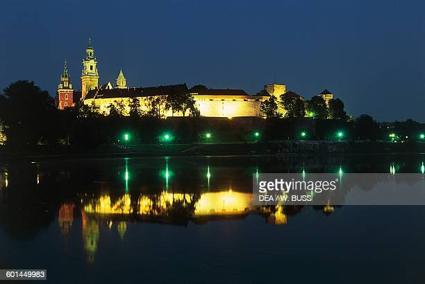 Wawel castle and Cathedral church of St Wenceslas and St Stanislaus on Wawel hill with the Vistula in the foreground Krakow's old town Lesser Poland...