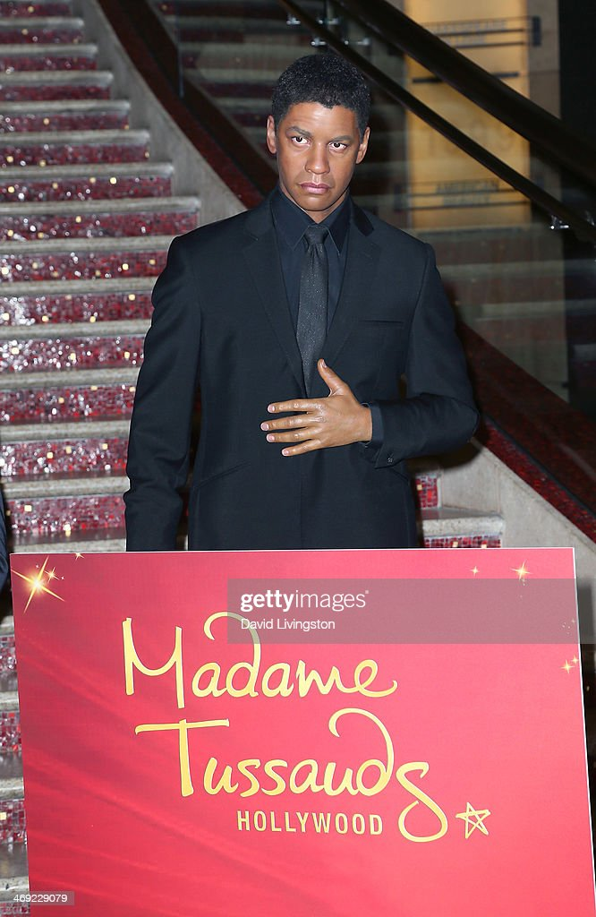 A wax figure of actor <a gi-track='captionPersonalityLinkClicked' href=/galleries/search?phrase=Denzel+Washington&family=editorial&specificpeople=171332 ng-click='$event.stopPropagation()'>Denzel Washington</a> from Madame Tussauds Hollywood is seen on the grand staircase to the Dolby Theatre on February 13, 2014 in Hollywood, California.