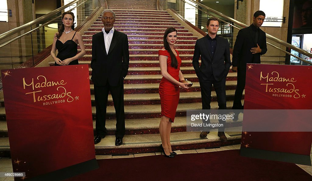 A wax figure of actress <a gi-track='captionPersonalityLinkClicked' href=/galleries/search?phrase=Sandra+Bullock&family=editorial&specificpeople=202248 ng-click='$event.stopPropagation()'>Sandra Bullock</a> (C) dressed for the red carpet is unveiled by Madame Tussauds Hollywood standing with wax figures (L-R) of actors Angelina Jolie, <a gi-track='captionPersonalityLinkClicked' href=/galleries/search?phrase=Morgan+Freeman&family=editorial&specificpeople=169833 ng-click='$event.stopPropagation()'>Morgan Freeman</a>, Leonardo DiCaprio and <a gi-track='captionPersonalityLinkClicked' href=/galleries/search?phrase=Denzel+Washington&family=editorial&specificpeople=171332 ng-click='$event.stopPropagation()'>Denzel Washington</a> at the grand staircase to the Dolby Theatre on February 13, 2014 in Hollywood, California.