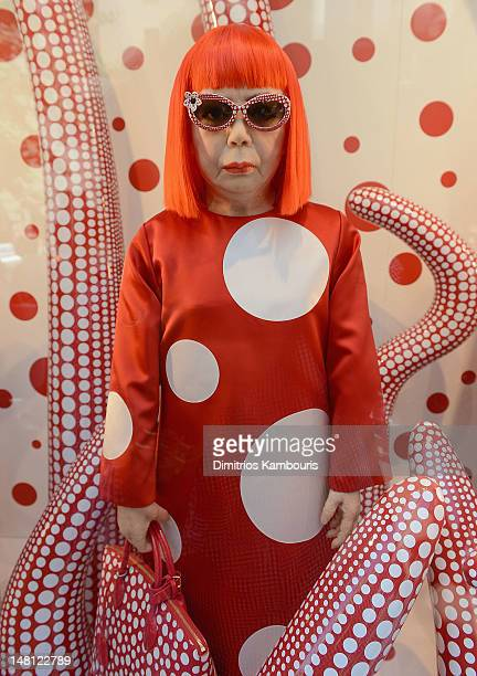 A wax figure of artist Yayoi Kusama on display during the Louis Vuitton And Yayoi Kusama Collaboration Unveiling at Louis Vuitton Maison on July 10...
