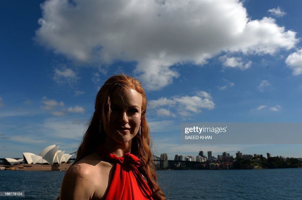 A wax figure of Australian actor Nicole Kidman wearing a birthday hat is displayed during a celebration of the first anniversary of Madame Tussauds Sydney in front of the Harbour Bridge and the Opera House in Sydney on April 17, 2013. Madame Tussauds Sydney organised a birthday party with wax figures of Australian celebrities including Nicole Kidman, Keith Urban, Dannii Minogue, Miranda Kerr, Eric Bana and Lleyton Hewitt. AFP PHOTO / Saeed Khan