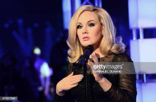 A wax figure of British singer Adele is unveiled for it's US debut during the launch of an interactive music experience exhibition at Madame Tussauds...