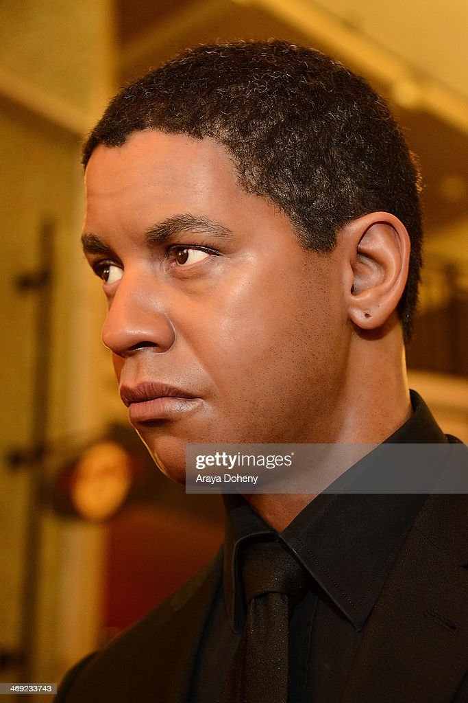 A wax figure of <a gi-track='captionPersonalityLinkClicked' href=/galleries/search?phrase=Denzel+Washington&family=editorial&specificpeople=171332 ng-click='$event.stopPropagation()'>Denzel Washington</a> at the Madame Tussauds Hollywood Unveils Sandra Bullock Wax Figure event at Madame Tussauds on February 13, 2014 in Hollywood, California.