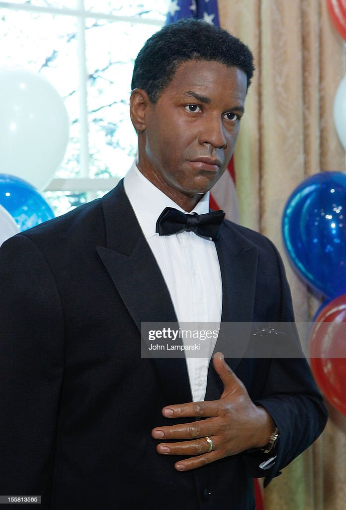 Wax figure of <a gi-track='captionPersonalityLinkClicked' href=/galleries/search?phrase=Denzel+Washington&family=editorial&specificpeople=171332 ng-click='$event.stopPropagation()'>Denzel Washington</a> is displayed as Madame Tussauds New York celebrates President Barack Obama's reelection at Madame Tussauds on November 8, 2012 in New York City.