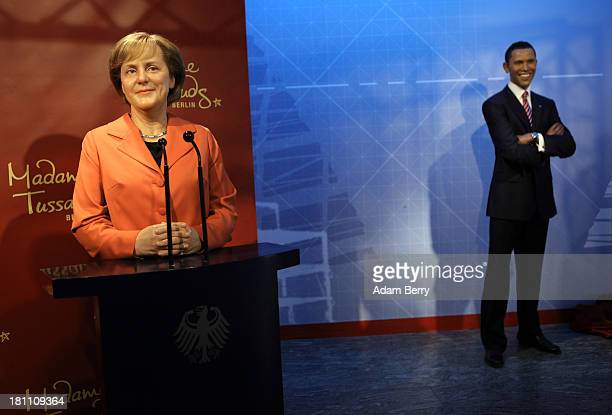 A wax figure of German Chancellor Angela Merkel from 2005 stands next to one of US President Barack Obama at Madame Tussauds wax museum on September...