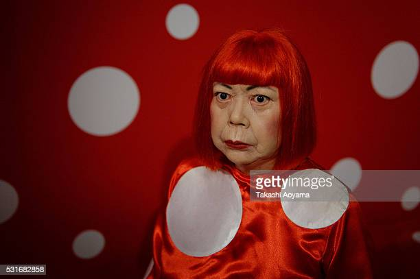 A wax figure of Japanese artist Yayoi Kusama is displayed at the Madame Tussauds Tokyo on May 16 2016 in Tokyo Japan Madame Tussauds wax museum in...