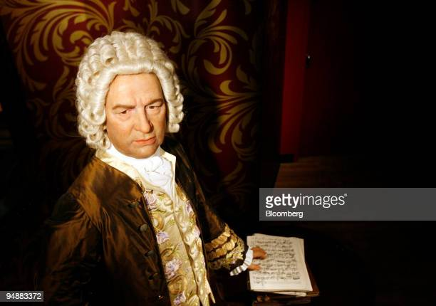 A wax figure of Johann Sebastian Bach German composer stands on display at Madame Tussauds prior to the exhibition's public opening in Berlin Germany...