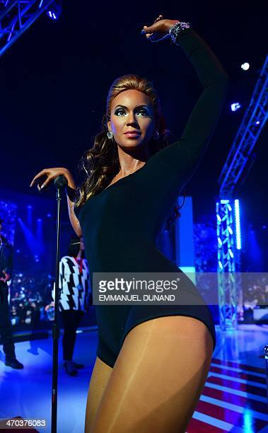 A wax figure of singer Beyonce is on display during the launch of an interactive music experience exhibition at Madame Tussauds in New York February...