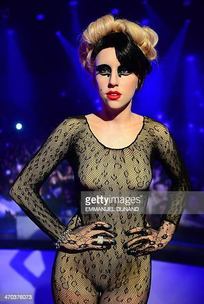 A wax figure of singer Lady Gaga is on display during the launch of an interactive music experience exhibition at Madame Tussauds in New York...