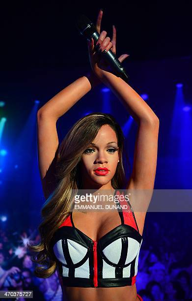 A wax figure of singer Rihanna is on display during the launch of an interactive music experience exhibition at Madame Tussauds in New York February...