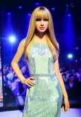 A wax figure of singer Taylor Swift is on display during the launch of an interactive music experience exhibition at Madame Tussauds in New York...