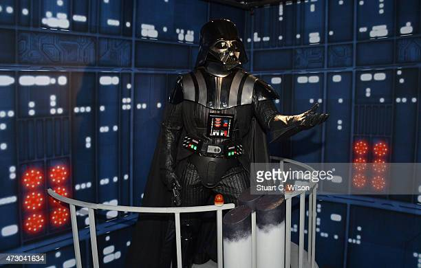 A wax figure of Star Wars character Darth Vader on display at 'Star Wars At Madame Tussauds' on May 12 2015 in London England
