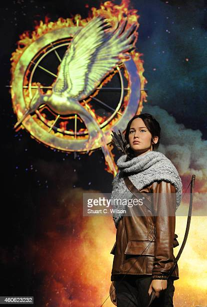 A wax figure of the Katniss Everdeen character from 'The Hunger Games' movies is unveiled at Madame Tussaud's London on December 18 2014 in London...
