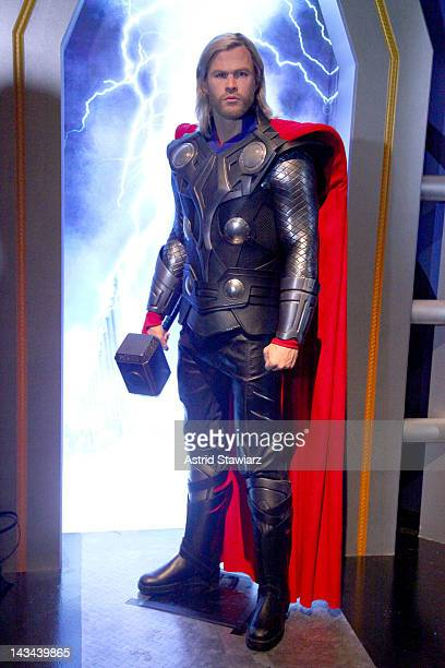 A wax figure of Thor as portrayed by actor Chris Hemsworth appears at the Madame Tussauds New York's Interactive Marvel Super Hero Experience at...