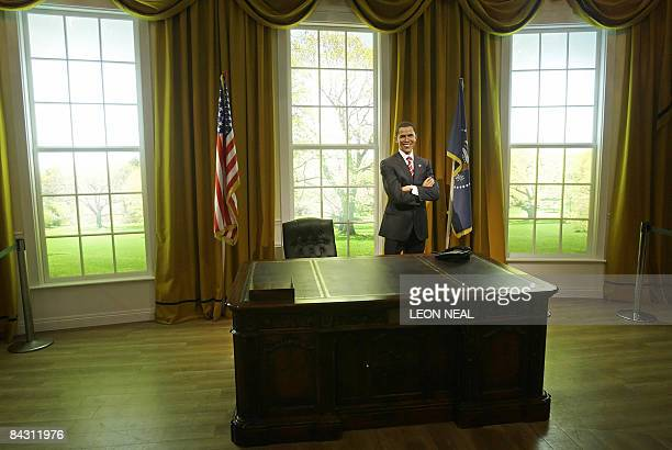 A wax figure of US Presidentelect Barack Obama is unveiled in a recreation of the White House's Oval Office at the Madame Tussauds waxwork museum in...