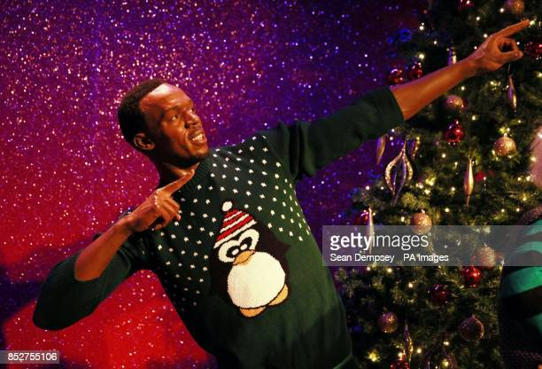 Wax figure of Usain Bolt as it dons a Christmas sweater to show support for Save the ChildrenOtildes Christmas Jumper Day to Ocircmake the world...