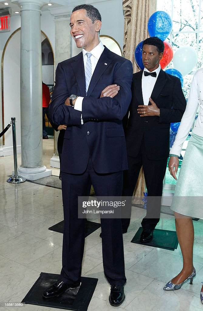 Wax figure U.S. President <a gi-track='captionPersonalityLinkClicked' href=/galleries/search?phrase=Barack+Obama&family=editorial&specificpeople=203260 ng-click='$event.stopPropagation()'>Barack Obama</a> and <a gi-track='captionPersonalityLinkClicked' href=/galleries/search?phrase=Denzel+Washington&family=editorial&specificpeople=171332 ng-click='$event.stopPropagation()'>Denzel Washington</a> are displayed as Madame Tussauds New York celebrates President <a gi-track='captionPersonalityLinkClicked' href=/galleries/search?phrase=Barack+Obama&family=editorial&specificpeople=203260 ng-click='$event.stopPropagation()'>Barack Obama</a>'s reelection at Madame Tussauds on November 8, 2012 in New York City.