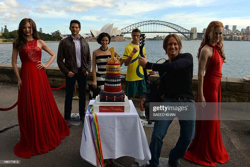 Wax figures of Australian celebrities are displayed during the celebration of the first anniversary of Madame Tussauds Sydney in front of the Harbour Bridge and the Opera House in Sydney on April 17, 2013. Madame Tussauds Sydney organised a birthday party with wax figures of Australian celebrities including Nicole Kidman, Keith Urban, Dannii Minogue, Miranda Kerr, Eric Bana and Lleyton Hewitt. AFP PHOTO / Saeed Khan