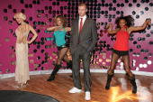 Wax figures of Christina Aguilera and Justin Timberlake are seen with dancers during the opening of Club MTNY featuring Justin and Christina at...