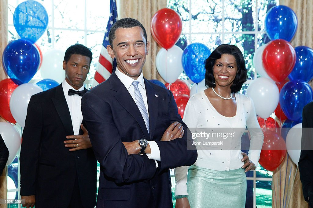 Wax figures of <a gi-track='captionPersonalityLinkClicked' href=/galleries/search?phrase=Denzel+Washington&family=editorial&specificpeople=171332 ng-click='$event.stopPropagation()'>Denzel Washington</a>, U.S. President Barack Obama and First Lady <a gi-track='captionPersonalityLinkClicked' href=/galleries/search?phrase=Michelle+Obama&family=editorial&specificpeople=2528864 ng-click='$event.stopPropagation()'>Michelle Obama</a> are displayed as Madame Tussauds New York celebrates President Barack Obama's reelection at Madame Tussauds on November 8, 2012 in New York City.