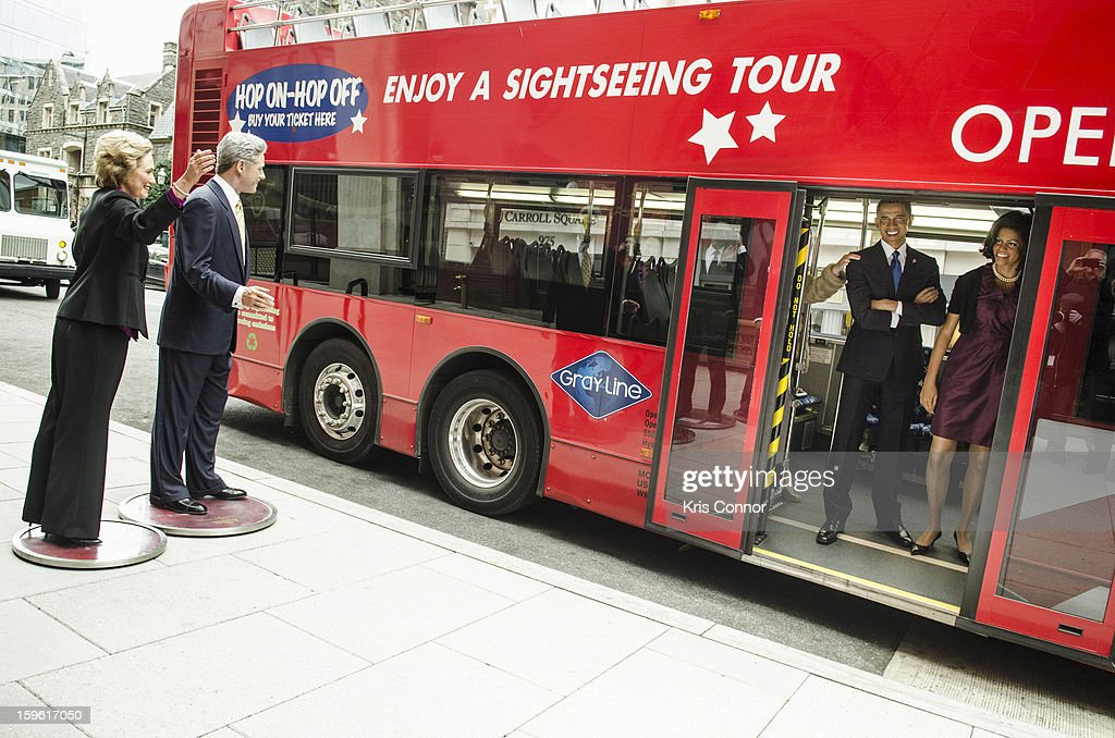 Wax figures of former first lady Hillary Clinton and former President Bill Clinton greet figures of President Barack Obama and first lady Michelle Obama Madame Tussauds DC Presidential Wax Figures Bus Tour on January 17, 2013 in Washington, United States.