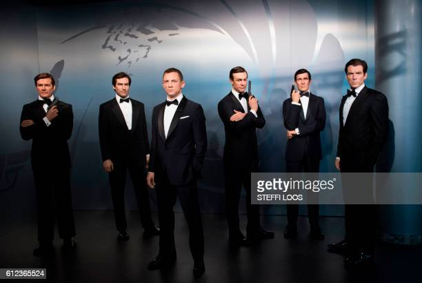 TOPSHOT Wax figures of James Bond actors Roger Moore Timothy Dalton Daniel Craig Sean Connery George Lazenby and Pierce Brosnan are presented at the...