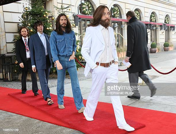 Wax figures of John Lennon George Harrison Paul McCartney and Ringo Starr as the 'Abbey Road' Beatles stand at the Hotel Adlon in Berlin on December...