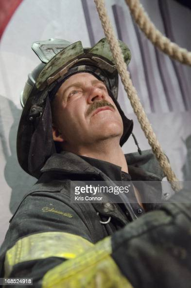 Wax figures of New York City firefighters raising the flag at ground zero are displayed during the Madame Tussauds 'HOPE Humanity And Heroism' 9/11...
